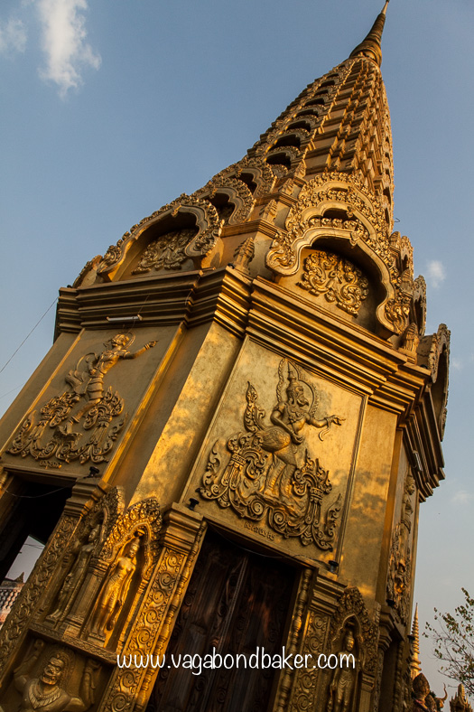 the golden spire of the temple on top of the hill.